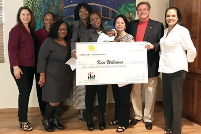 On behalf of Chris Evert Charities, officials from the Ounce of Prevention Fund of Florida present the Vitas Gerulaitis Memorial Scholarship to Tallahassee's Kesi Williams.